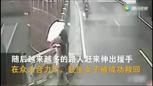 女子路口欲轻生!惊险之际!监控拍下意外一幕!