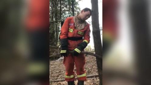 心疼!广东佛山凌云山森林山火已全部扑灭  消防员累得靠树睡着