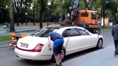 迈巴赫违停被拖车,结果死活赖着不走,拖车:这么重你好意思?