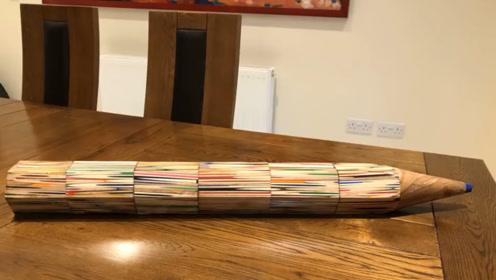 小伙将100支笔拼装成一支,这么大的铅笔,写起字来真滑稽!
