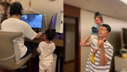 陈赫专心打游戏女儿站一旁注视 笑侃:别看了矮子
