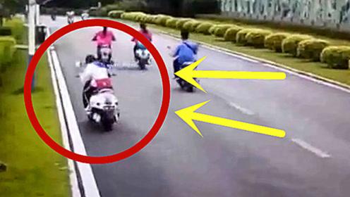 太惨了!女学生骑车只顾玩手机,下一秒让她后悔莫及!