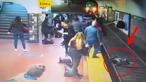 命悬一线!男子在站台突然晕,无辜妇女被撞下铁轨,监控拍下全过程