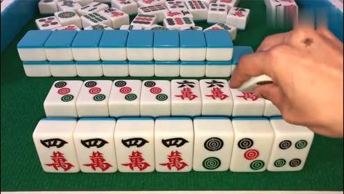 小伙打麻将手气真好,连开三杠杠上花,就是三筒有点多了