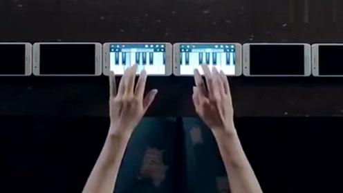 """熟练演奏钢琴曲,6台手机在""""音乐家""""手中,玩出不一样的高度"""
