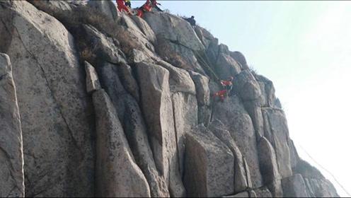 泰山一游客拍照时不慎坠崖身体卡石缝:距崖顶4米高,身后即悬崖