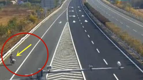 男子骑自行车逆行上高速,要不是监控拍下,谁会相信这一切!