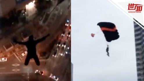作死!在韩国摩天楼顶大玩跳伞 两俄男子被禁止出境