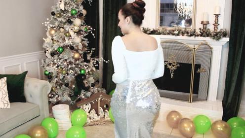 银色亮片裙闪耀亮眼,搭配白色紧身衣与高发髻优雅灵动