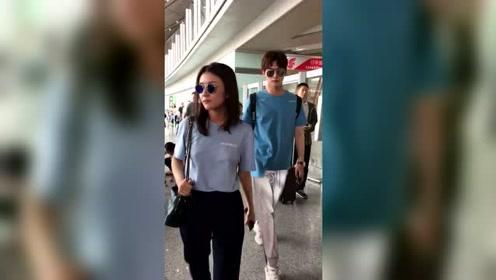 邢昭林携八王妃现身机场 大长腿超抢镜