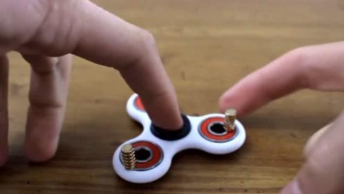 一个快速转动的指尖陀螺,当连上磁铁和另一个陀螺,为什么停止了?