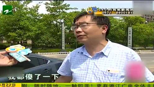 杭州遭遇强对流天气 男子的车子被强风吹翻的广告牌砸了