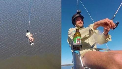老外搞怪出新高度:搭无人机上天,边喝酒边钓鱼