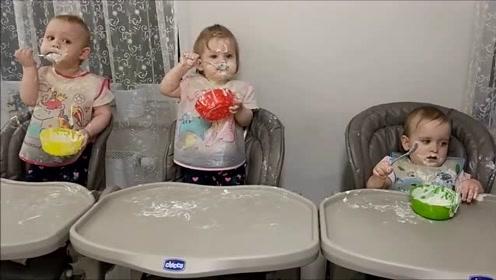 三胞胎自己吃辅食,瞬间变车祸现场,这三个小花猫真是太可爱了