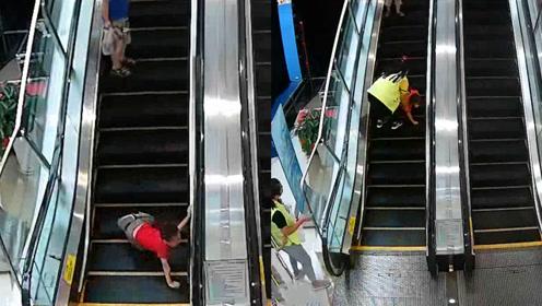 男孩商场滚落电梯,危急时刻美女飞奔救人,现场监控视频曝光
