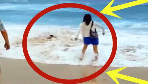 粗心父母任由孩子海边玩耍,下秒瞬间双双崩溃,网友:差一点!