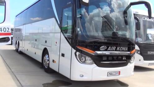 国外的大客车真高级,车内还有卫生间和休息室,档杆在哪里?