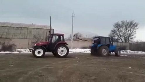 俄罗斯农民用中国产拖拉机与本土拖拉机来次拔河较量,结果让他很开心