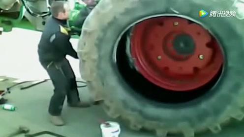 看国外牛人怎么维修比人还高的拖拉机轮胎,这技术大写的服