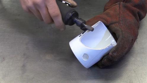 杯子烂了工人师傅舍不得扔,用电焊机修一修,成品就像买了个新的