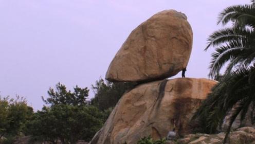 """贵州深山藏有一块""""奇石"""",几吨重巨石风能吹动,双手就能推动"""