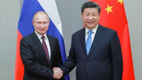 习近平会见俄罗斯总统普京 中俄共同营造公平公正的国际环