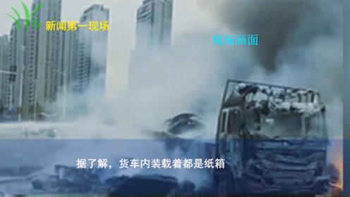 货车经过路口时起火现场浓烟滚滚  明火被扑灭后车已被烧剩下车架子