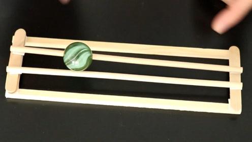 科学小实验:自动上坡的玻璃球,你见过吗?一起来看下