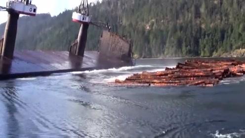 大型货船卸货不用愁,一个倾斜就完事,场面相当壮观!