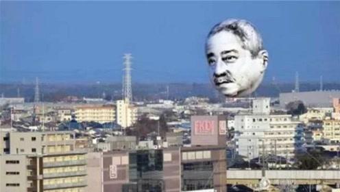 """飞天人头!日本艺术家创作""""诡异""""景观,24小时俯视路上行人!"""