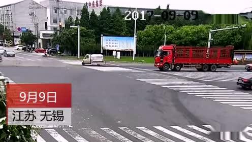 老人骑电动车闯红灯 被撞飞几十米