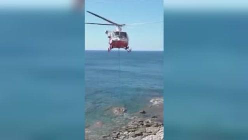 拉风!意大利消防队出动直升机救被困悬崖的奶牛