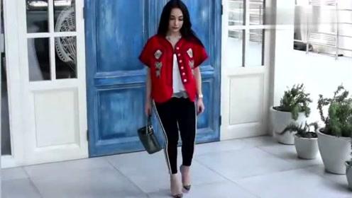 红色绣花上衣,搭配紧身裤,真的很靓丽