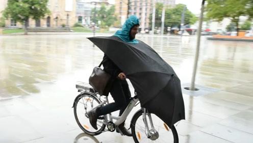 德国大叔发明自行车雨伞,下雨骑车更安全,获得创意设计大奖