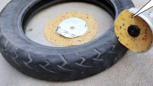 老外将薄饼安装在角磨机上,并试图切割轮胎,网友:这是闹着玩呢