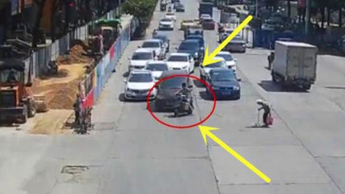 感动!看到老人过马路,电动车男子用身体为她挡住车流