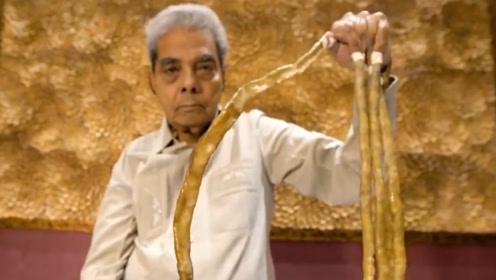 世界上最长指甲,老外留66年长9米,剪掉后发生不可思议的一幕