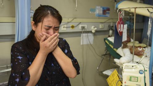 男孩被煤气罐炸伤50天治疗费超50万 母亲不堪压力几度欲自尽