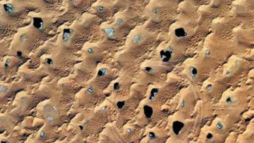 美国卫星路过中国沙漠地区:出现神秘黑点,科学家们坐不住了