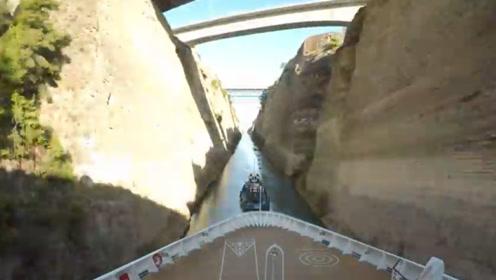 难以置信!巨型游轮穿过24米宽运河 乘客伸手可摸到崖壁