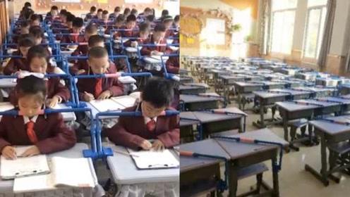 小学课桌装矫正器,趴着写字就被卡,家长支持:由家长统一购买