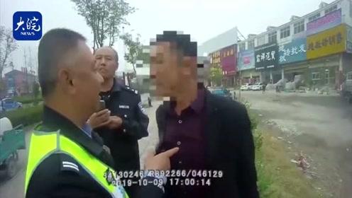 """安徽萧县:醉酒男子大闹执法现场 对交警放言""""你没资格和我说话"""""""