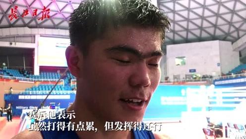 中国拳击运动员唐拉提汗5:0胜刚果,赛完汗如雨下:有点累,但还行