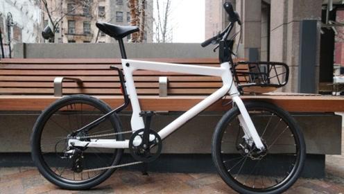 这自行车居然电动的,一次充电可跑六十多公里,可跑北京四环一圈