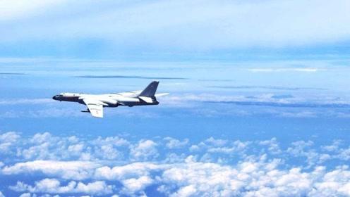 轰6-K飞行员曝绕岛巡航时遭挑衅:不明飞机间隔30米亮出导弹