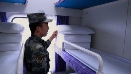 退伍军人下火车前,把卧铺被子叠成豆腐块,乘务员却犯了难