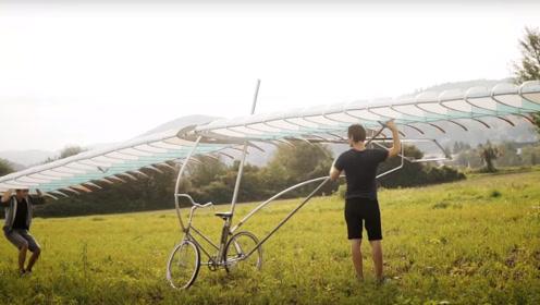 外国小哥在自行车上安装机翼,真的能在天上行驶吗?网友:有点怂了