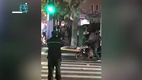 突发!上海一男子挥舞菜刀冲向群众 无视警告后民警果断开枪将其击伤