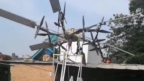 小伙制作了一个大型的螺旋桨,放在自己的院落里面,不知道有什么用途!