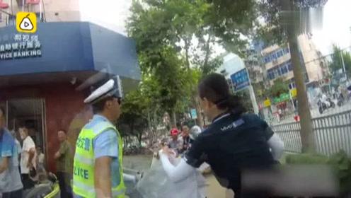 骑车违规被拦,哺乳期女子大骂交警!